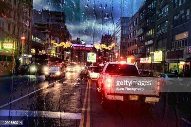 view from dashboard with rain drops of traffic jam in the streets of manhattan, new york city - dashboard camera point of view stock photos and pictures