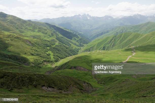 view from datvis jvari pass, caucasus mountains, georgia - argenberg stock pictures, royalty-free photos & images
