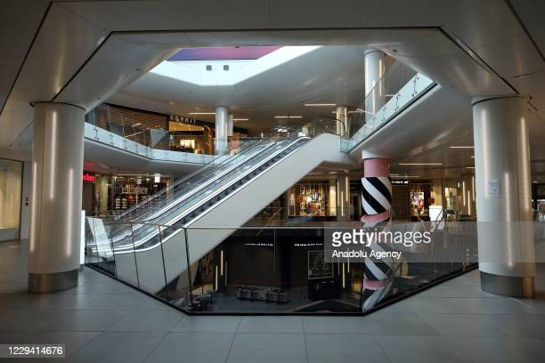View from empty shopping mall and closed stores after Belgian authorities has decided to impose a restriction to fight against the novel coroavirus...