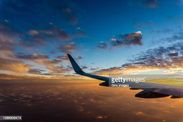 view from flying plane of sunset, china - image stockfoto's en -beelden