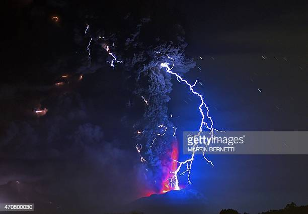 View from Frutillar, southern Chile, showing volcanic lightnings and lava spewed from the Calbuco volcano on April 23, 2015. Chile's Calbuco volcano...