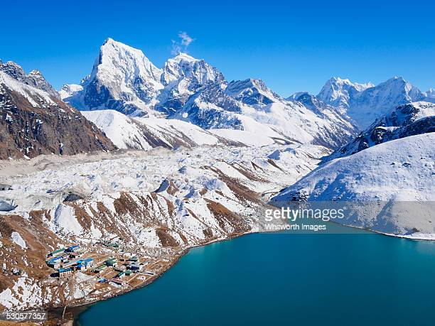 view from gokyo ri over village, lake, glacier - gokyo ri ストックフォトと画像