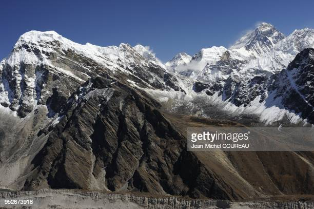 View from Gokyo Ri with the Ngozumpa Glacier is a grey glacier covered with stone and with dust ON the top the Everest mount at 8848 ms