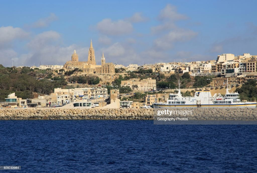 view from gozo channel line ferry ship approaching port of mgarr