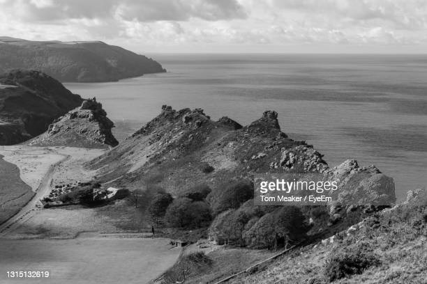 view from hollerday hill of the valley of the rocks in exmoor national park - lynton stock pictures, royalty-free photos & images