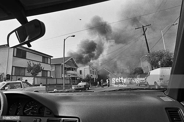 View from inside a car of a business burning down in the Pico/Union area of Los Angeles. Los Angeles has undergone several days of rioting due to the...