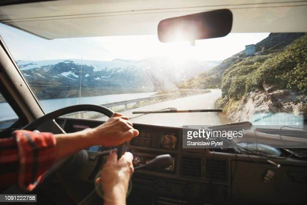 view from inside of campervan when traveling on beautiful road at sunsrise - vehicle interior stock pictures, royalty-free photos & images