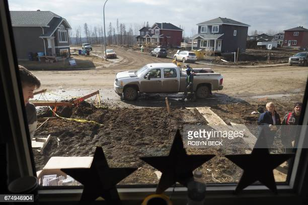 A view from inside the home of Steve Menard as he and his neighbors rebuild after a massive fire in Fort McMurray Canada April 19 2017 A few...