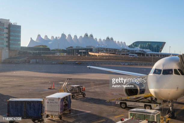 view from inside the terminal at denver international airport - denver international airport stock pictures, royalty-free photos & images