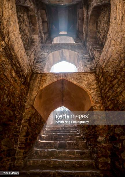 view from inside the well at ugrasen ki baoli, new delhi - stepwell stock photos and pictures
