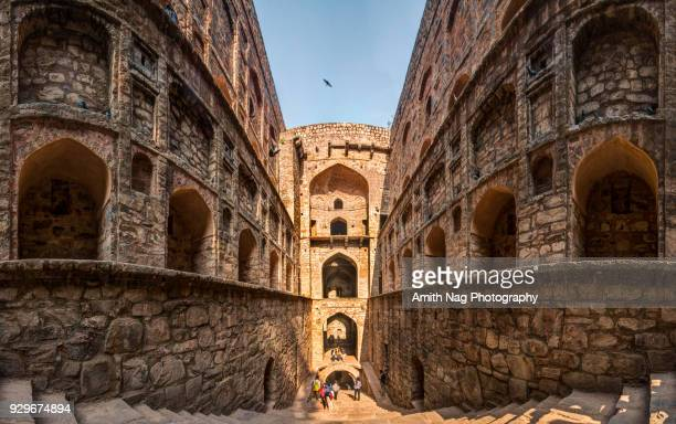 view from inside the well at ugrasen ki baoli, new delhi - tradition stock pictures, royalty-free photos & images