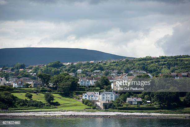 view from irish sea on larne in the county antrim of northern ireland - irish sea stock pictures, royalty-free photos & images