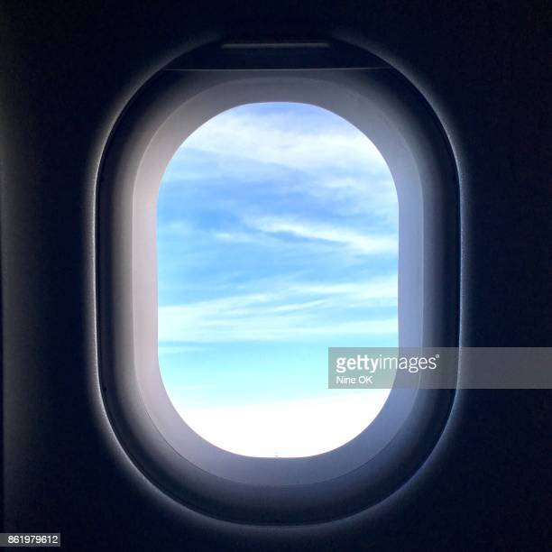 view from jet window - porthole stock photos and pictures