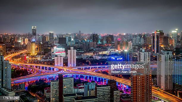 CONTENT] View from JW Marriott hotel in Shanghai evening cityscape of one of the busiest highway junctions in the city