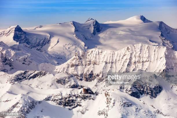 view from kitzsteinhorn on the mountains around grossvenediger group, austria - franz aberham stock photos and pictures