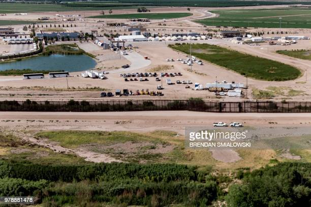 TOPSHOT A view from Mexico of the US Customs and Border Protection is housing underage people caught illegally entering the United States at the...