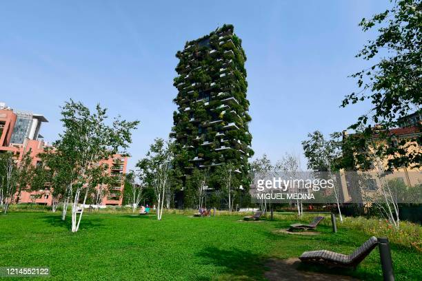 """View from Milan's botanical park """"Library of Trees"""" in the Porta Nuova district on May 22, 2020 shows the Vertical Forest high-rise complex , as the..."""