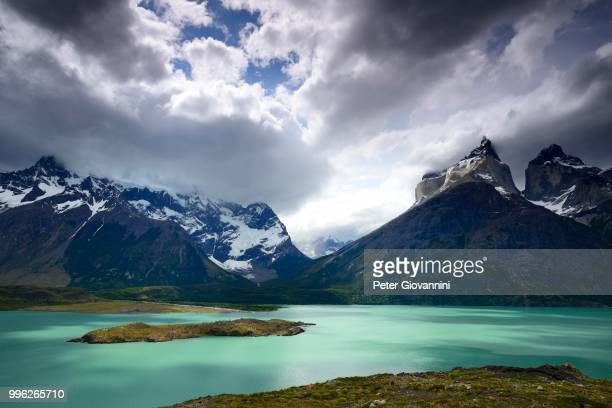 View from Mirador over Lake Pehoe to the mountains Los Cuernos with clouds, National Park Torres del Paine, Province Ultima Esperanza, Chile