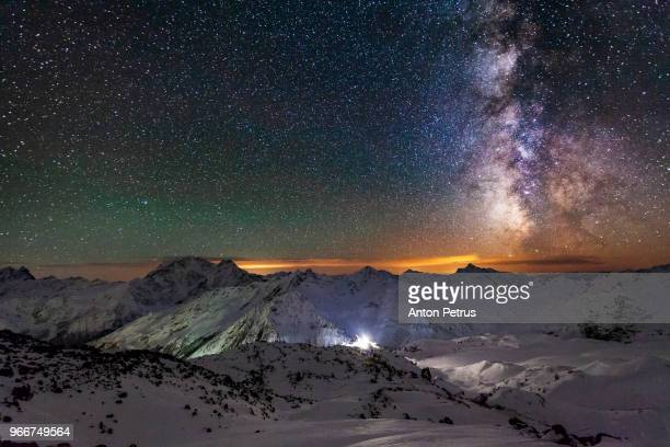 view from mount elbrus to the main caucasian range at night - anton petrus panorama of beautiful sunrise stock pictures, royalty-free photos & images