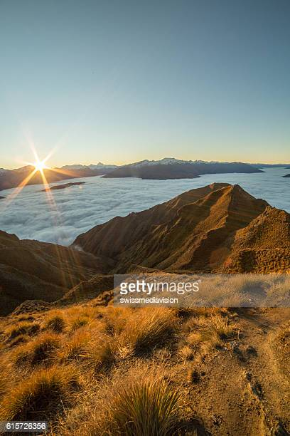 view from mountain summit, sunset above the clouds - otago region stock pictures, royalty-free photos & images