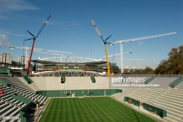 View from new No 2 Court as two cranes work in tandem to lift roof trusses on to fixed roof of Centre Court All England Lawn Tennis Club Wimbledon...