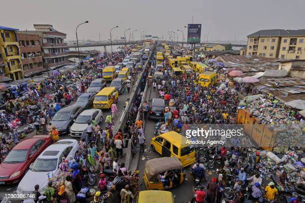 View from Nigeria's Lagos city as people continuing their daily lives in crowded area amid the novel coronavirus pandemic, on December 25, 2020....