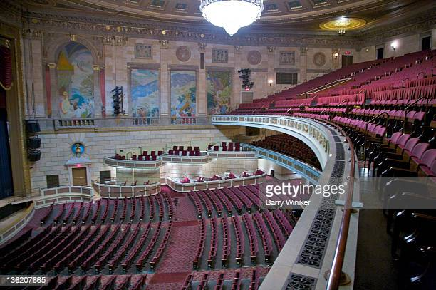View from on high of theater murals and seats.