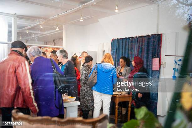 view from outside of a creative pop up store, lots of customers - pop up store stock pictures, royalty-free photos & images