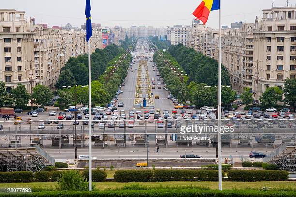 View from Palace of Parliment down boulevard to Piata Unirii and Romanian flag, Bucharest, Romania