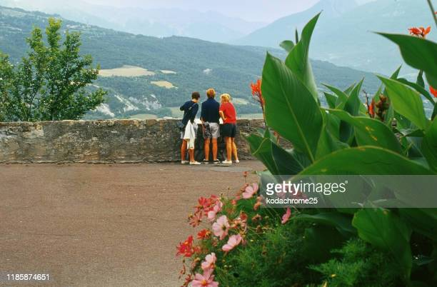 view from park in alpine town of embrun in the french alps france - embrun stock pictures, royalty-free photos & images