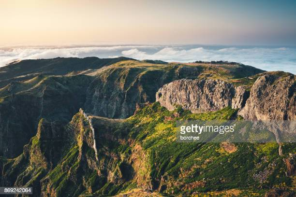 view from pico de arieiro at sunrise - madeira island stock photos and pictures