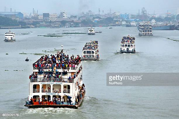 A View from Postagola Bridge in Dhaka Bangladesh show passengers travel on the Launches carrying leaving for their hometowns for the upcoming Eid...