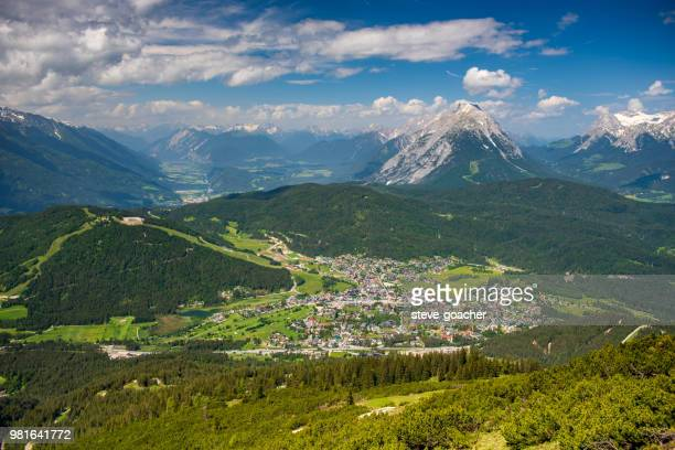 view from rosshütte looking down on seefeld and the inn river valley beyond - seefeld stock photos and pictures