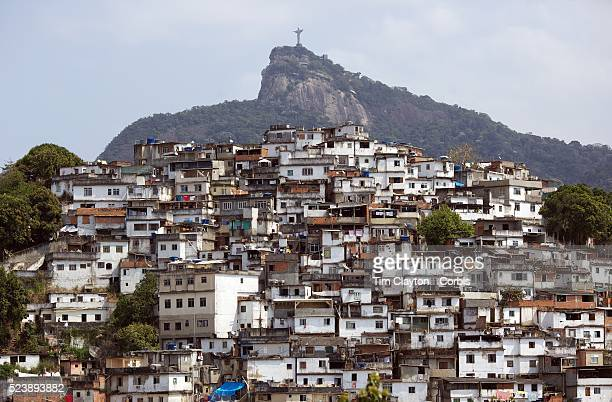A view from Santa Teresa in the hills of Rio de Janeiro as The iconic Cristo Redentor Christ the Redeemer statue sits atop the mountain Corcovado In...