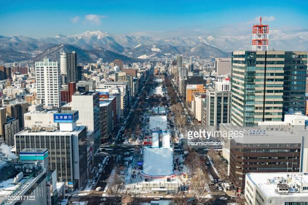 view from sapporo tv tower over sapporo - sapporo stock pictures, royalty-free photos & images