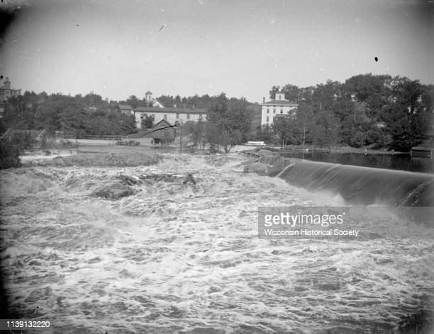 View from shoreline looking across the churning water just below the dam Black River Falls Wisconsin 1910 On the opposite shoreline is the town of...