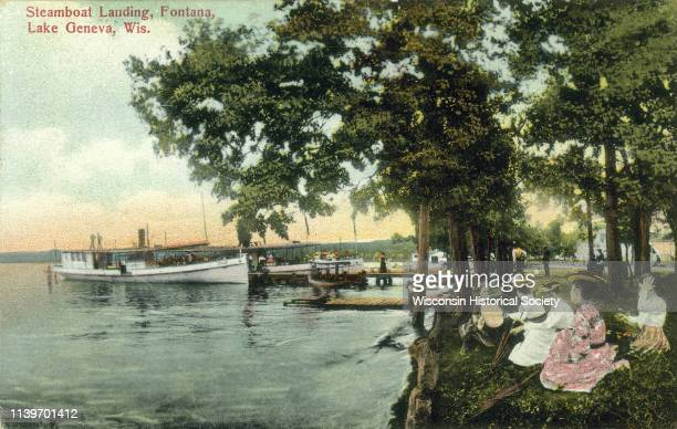 View from shoreline of a steamboat landing on Lake Geneva Fontana Wisconsin 1905 A group of women are gathered on the shore