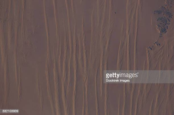 View from space of linear dunes in the Great Sand Sea in southwest Egypt.