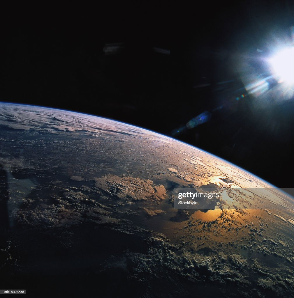 view from space of the suns rays falling on earth : Stock Photo