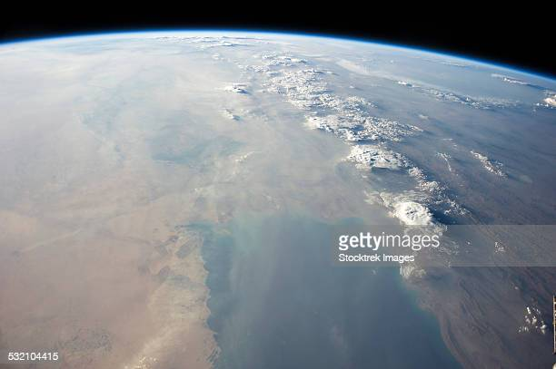 view from space showing the tropical blue waters of the persian gulf. - gulf of oman ストックフォトと画像