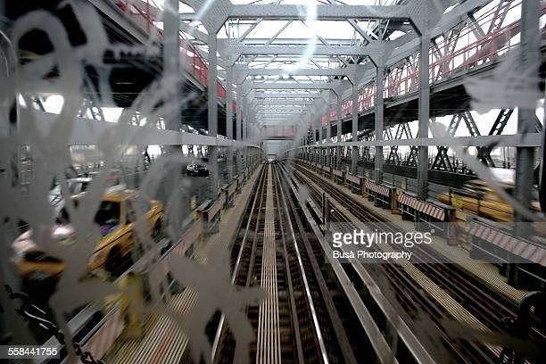 view from subway car over the manhattan bridge, ny - train graffiti stock photos and pictures