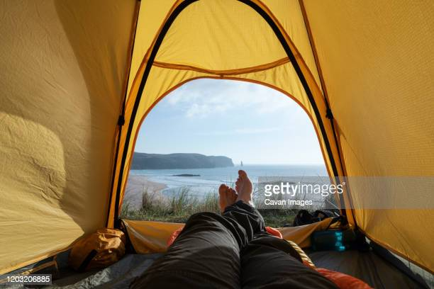 view from tent wild camping at sandwood bay beach, sutherland, scotland - scotland stock pictures, royalty-free photos & images