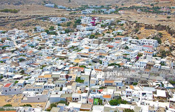 View from the Acropolis of Lindos down to the traditional white cubic houses in town on July 04 2010 in Lindos Greece The old town of Lindos is...