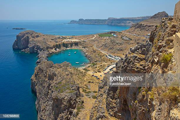 View from the Acropolis of Lindos to the old harbour Ajios Pavlos the most beautiful bay on July 04 2010 in Lindos Greece The old town of Lindos is...