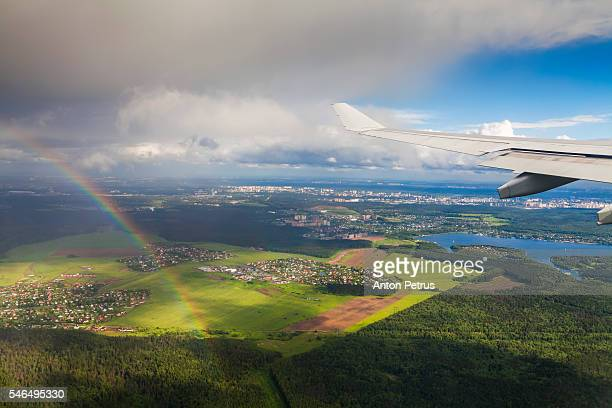 View from the airplane window on a rainbow background