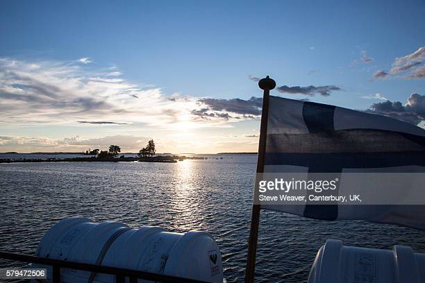 a view from the back of a docked ferry - finnish flag stock photos and pictures