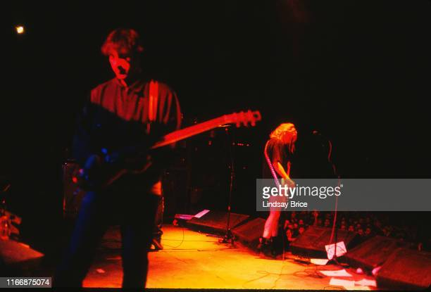 View from the back of the stage of guitarist and vocalist Thurston Moore bassist and vocalist Kim Gordon and guitarist Lee Renaldo as they perform in...