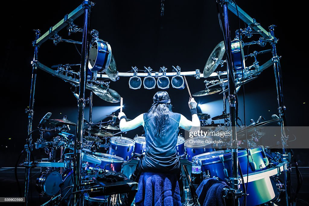 A view from the back of the stage showing drummer Mike Mangini of Dream Theater performing behind a large rack-mounted drum kit at Wembley Arena on February 14, 2014 in London, England.