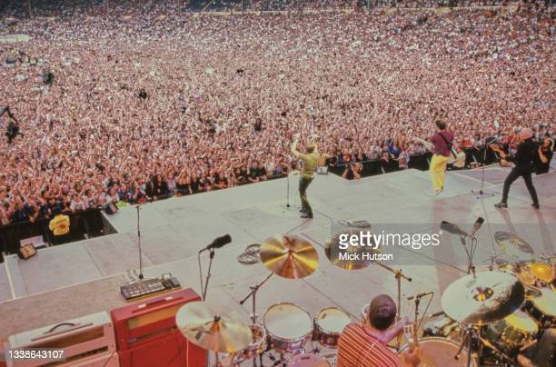 View from the back of the stage where Bryan Adams is performing in front of a large crowd at Wembley Stadium, London, UK, 27th July 1996.