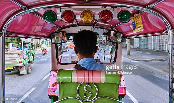 view from the back seat of a pink tuk tuk in bangkok thailand - auto rickshaw stock pictures, royalty-free photos & images
